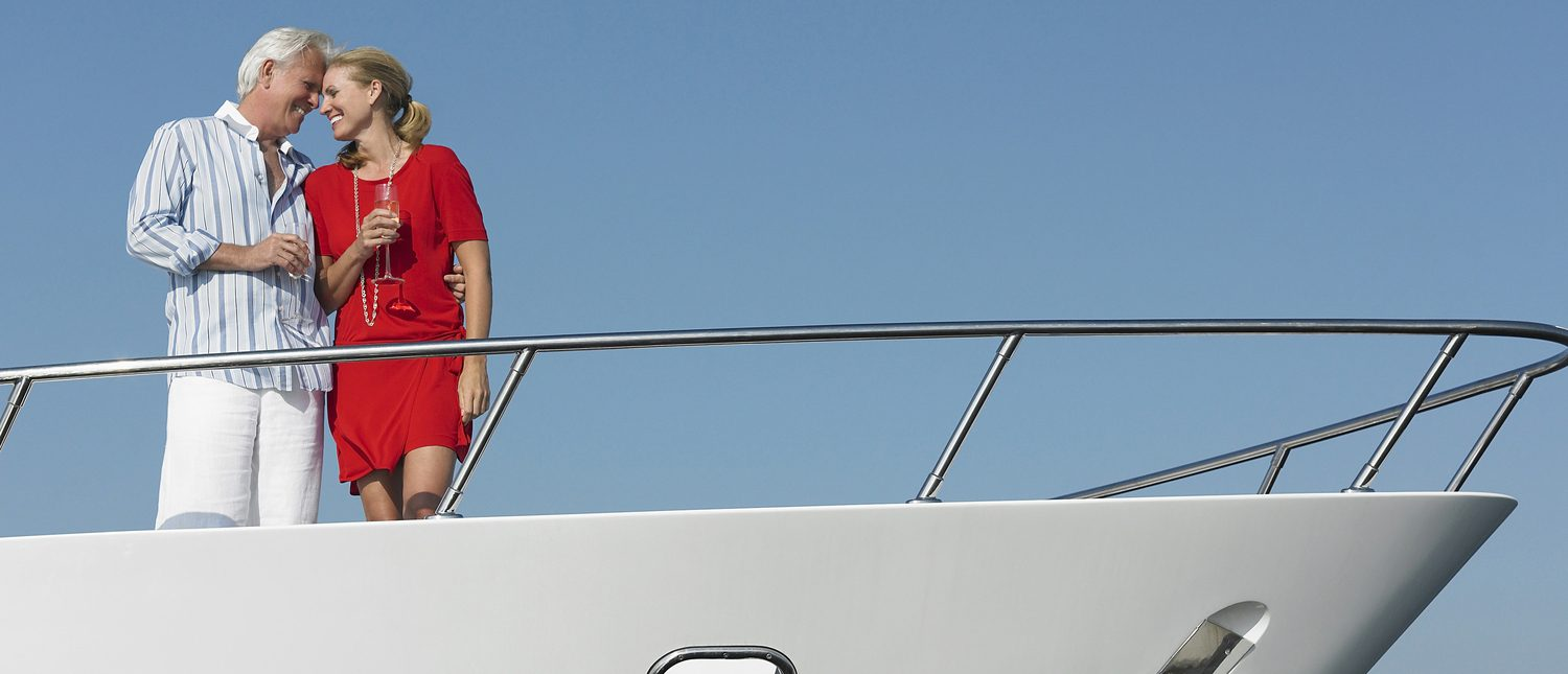 couple hugging on bow of yacht
